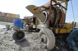 The mixer is slowly encased in concrete as they work. At the end of the job they will use pick-axes to break it out.