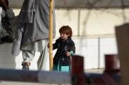 A little girl waiting outside the Shah Joy hospital