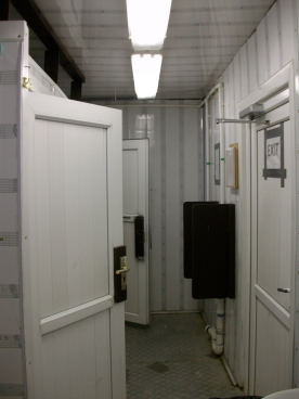 Looking the other direction of the latrine trailer - towards the toilets & urinals