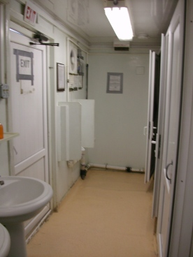 Looking the other way - 2 urinals & 3 toilet stalls