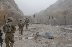 Members of C Co. 1-24 Infantry and the Zabul Agribusiness Development Team (ADT) conduct a foot patrol near Mizan to inspect the dam built by the previous ADT.