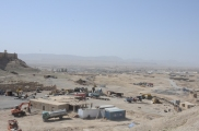 looking across the gravel/concrete plant towards the southern portion of Qalat City