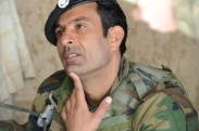 An Afghan National Army (ANA) soldier listens during a shura in Shah Joy