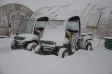 the John Deere Gators covered in snow