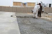 spreading the concrete