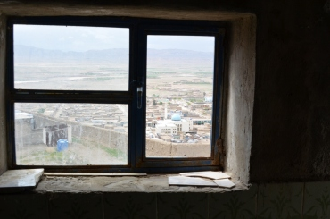 Qalat City through a broken window