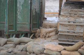 water leaking past the dozer/sandbag dike