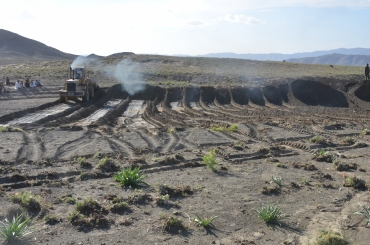 building a water diversion with a dozer and a bucket loader