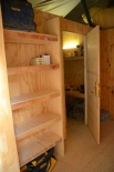 The shelving unit in the entryway - looking towards the ADT OIC's room