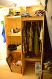The ADT OIC now has a closet for hanging clothes and a fairly spacious shelving unit.