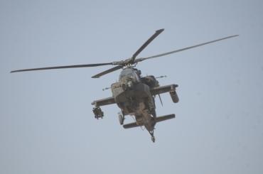 We had an AH-64 escort while on patrol in Mizan December 2011