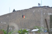 The Afghan flag flying in the background over the Mizan District Center