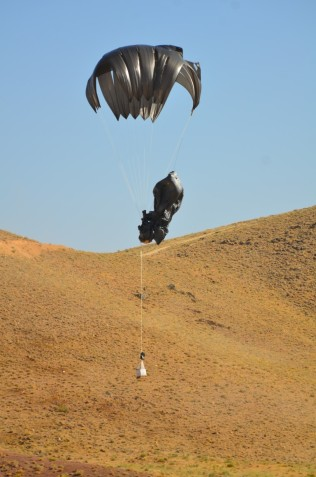 a bundle became entangled with another bundle's chute - they both landed safely.