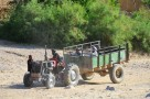 A tractor traveling down the dried river bed