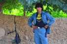 An Afghan Policeman stands watch near the shura