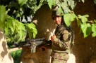 An Afghan National Army Soldier helps secure the area