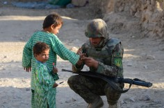 An Afghan soldier demonstrating how the pen works